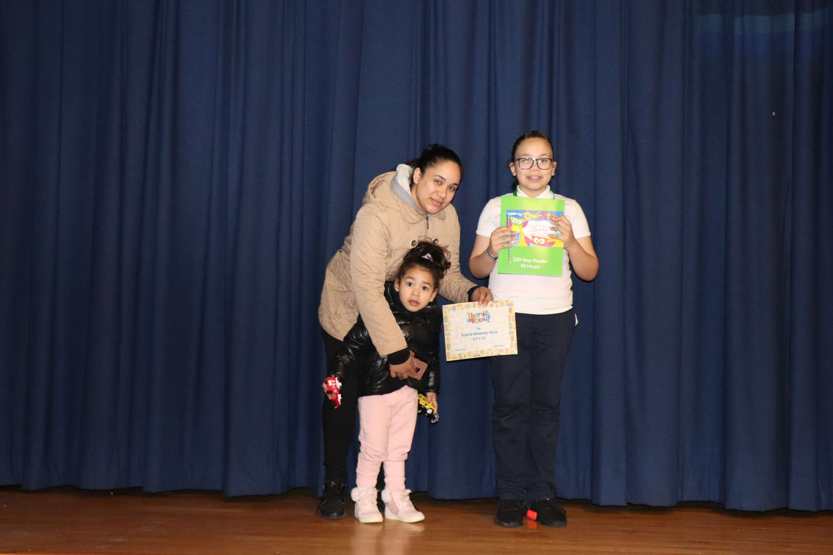 Parent with their child who is student of the month.