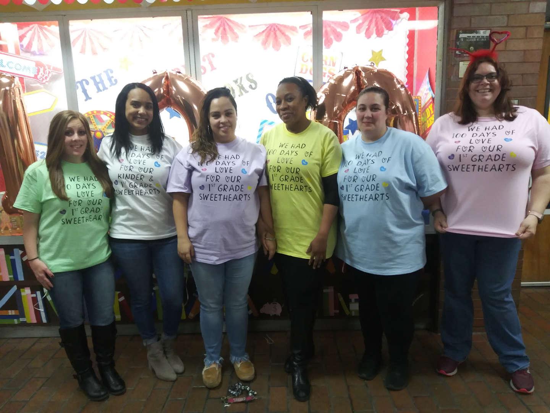 First Grade Teachers wearing matching shirts.
