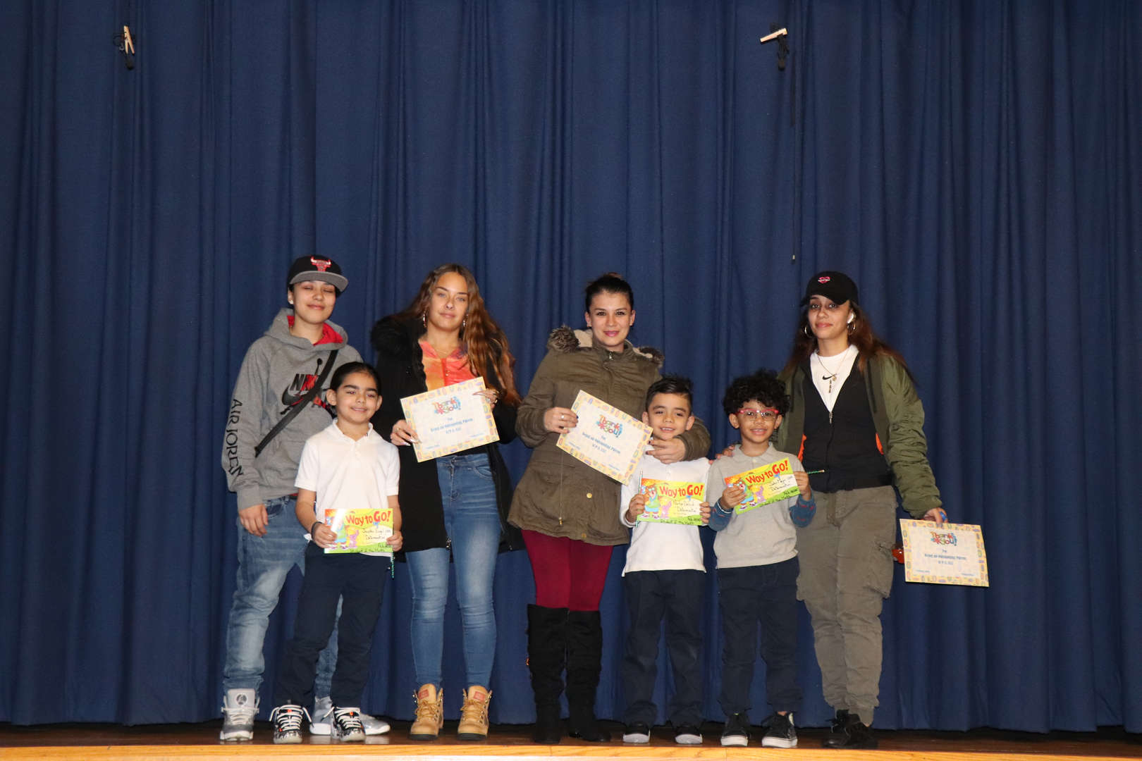 First Grade Parents with their children who are student of the month.