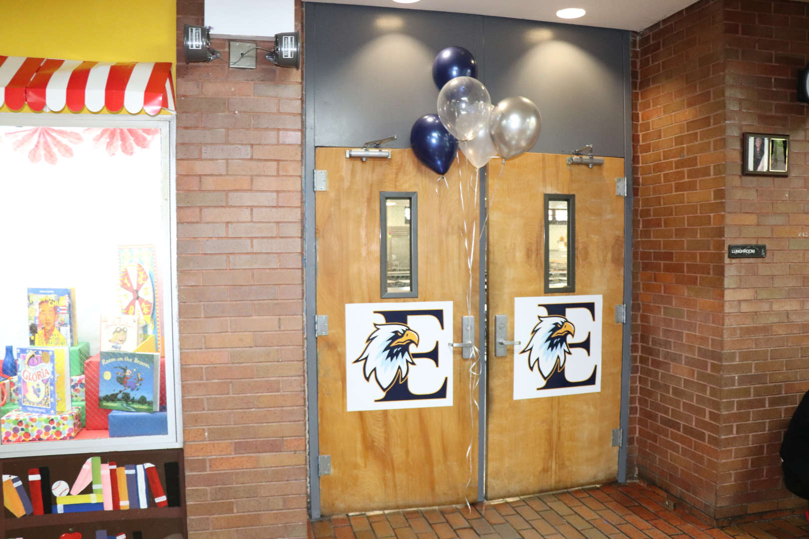 PS 152's logo decorating the outside of the cafeteria doors.