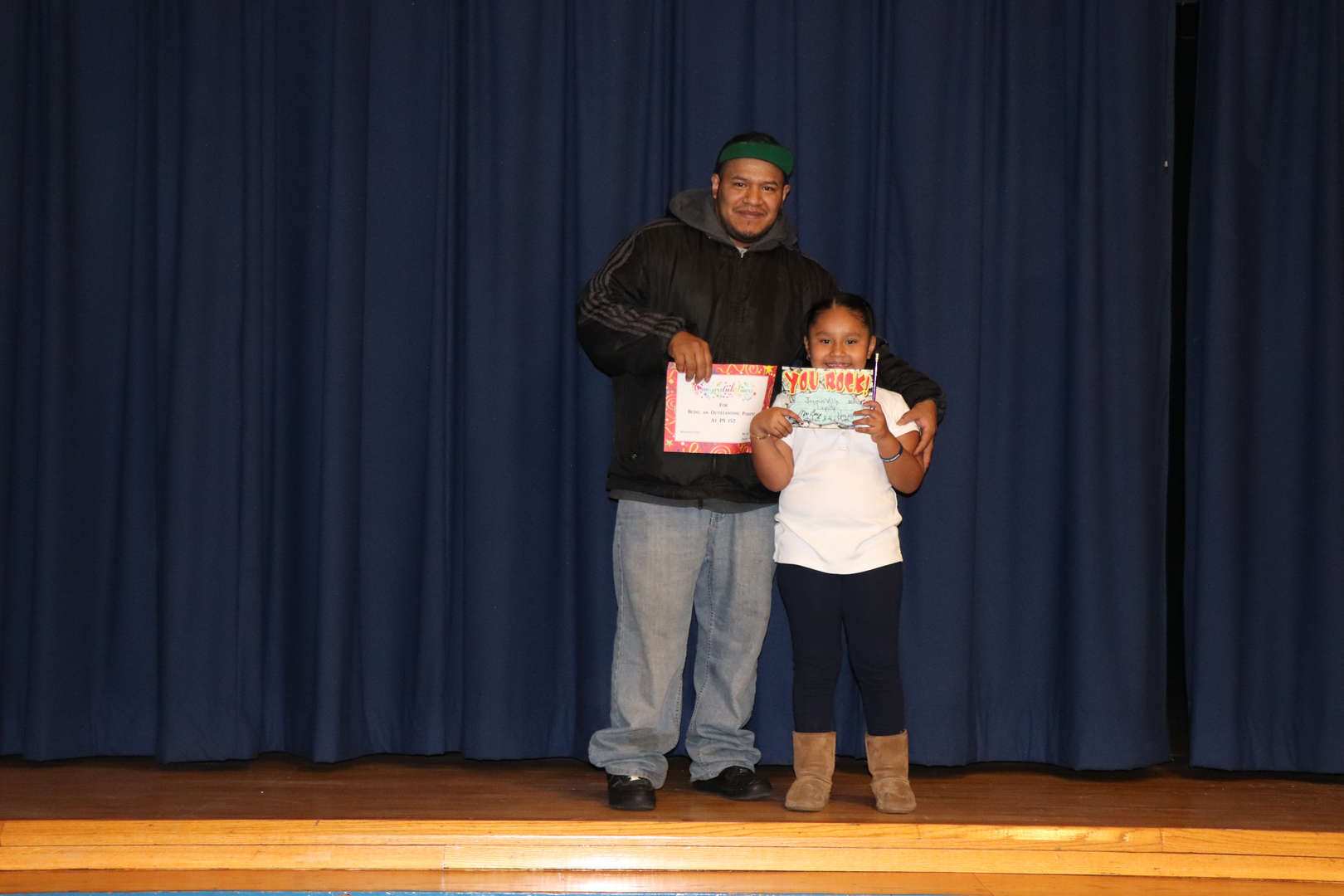 Second Grade parent with their child who is student of the month.