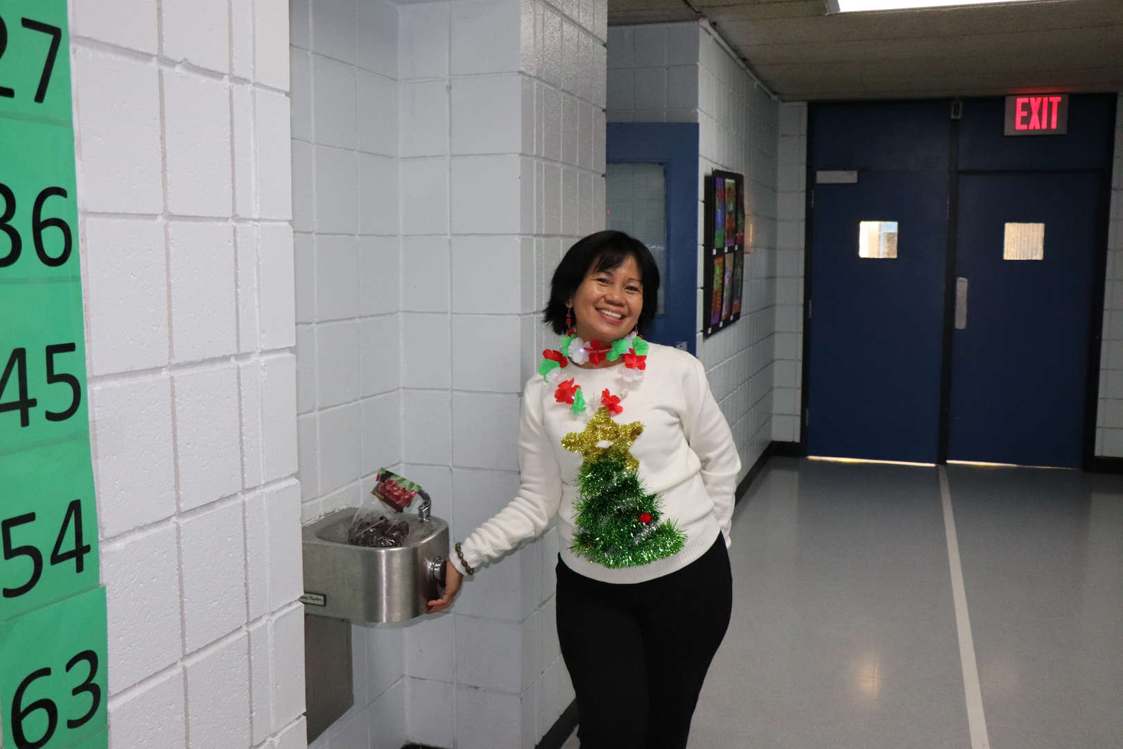 One of PS 152's paras in her ugly Christmas sweater.