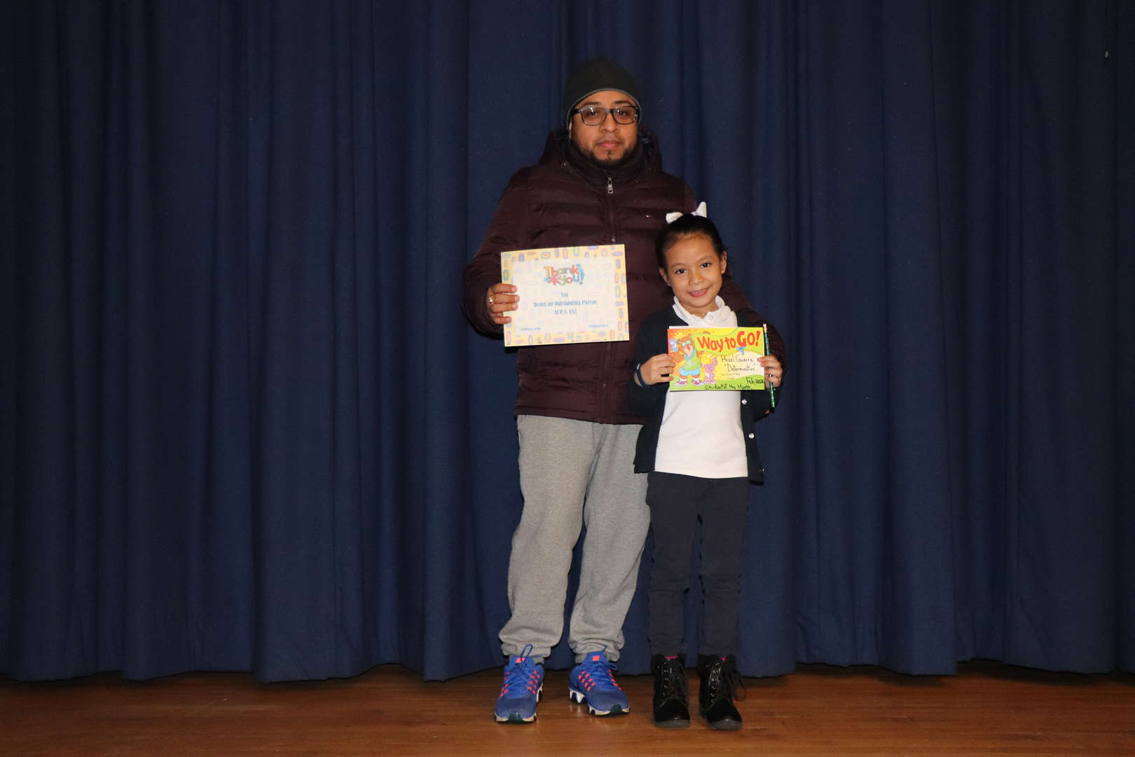 Parent with her child who is student of the month.