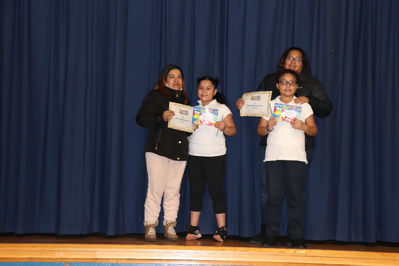 Third grade Parents with their children who are student of the month.