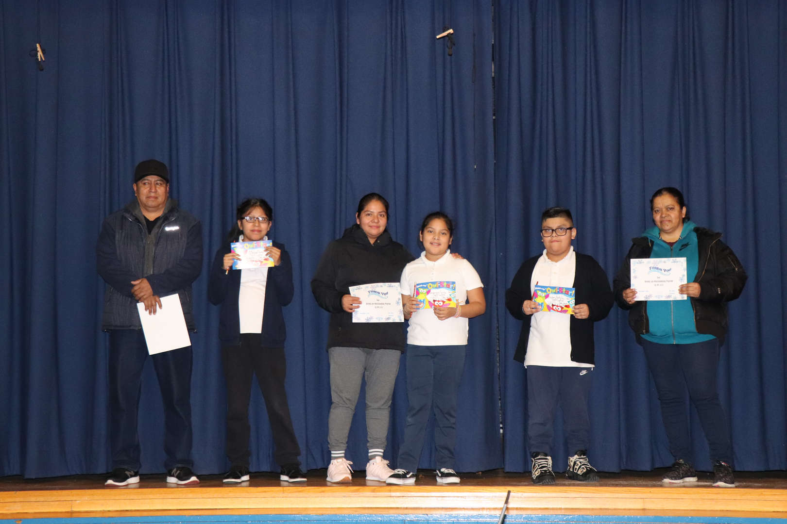 Fifth Grade Parents with their children who are students of the month.