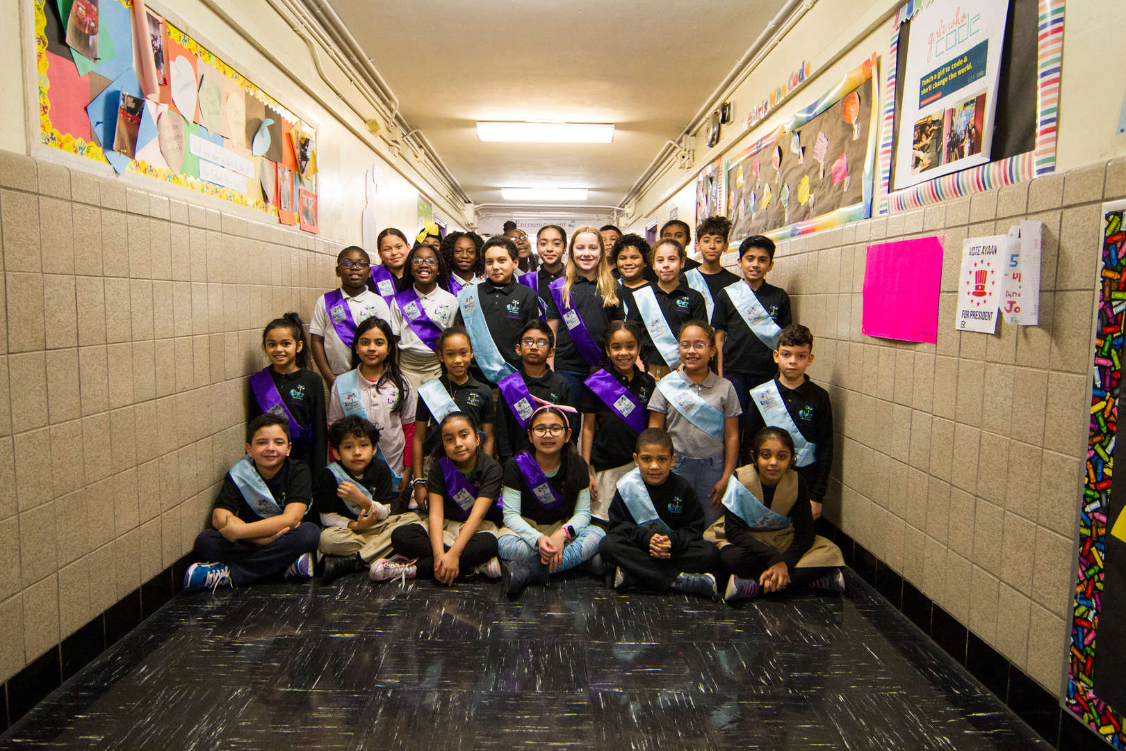 Students posing in hallway