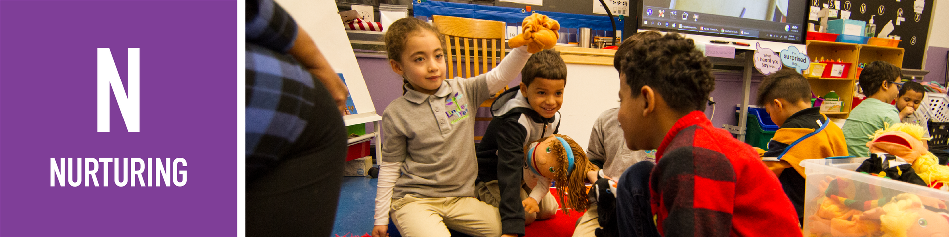 Nurturing: students play with puppet