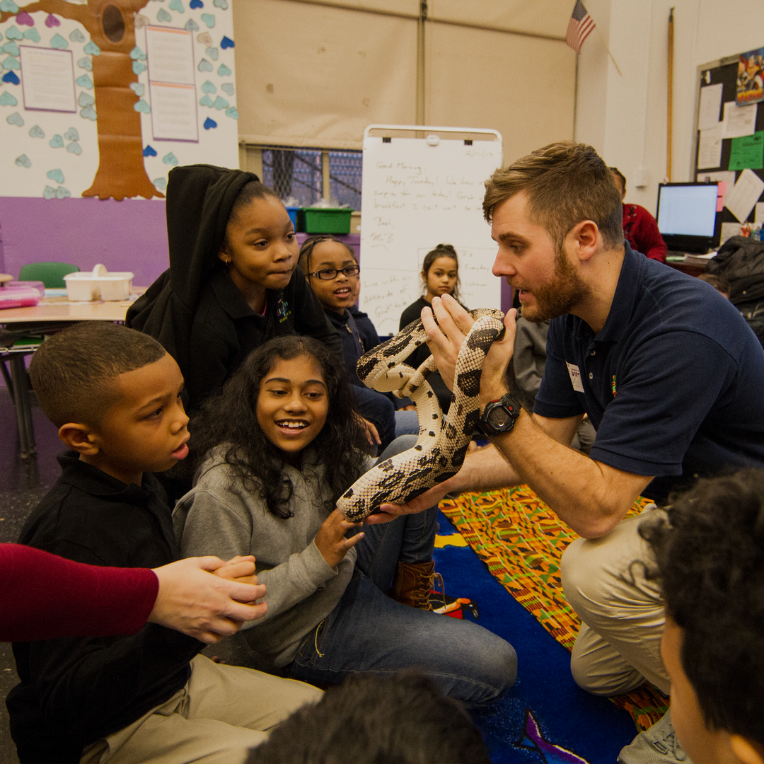 Bronx Zoo visitor shows animal to students