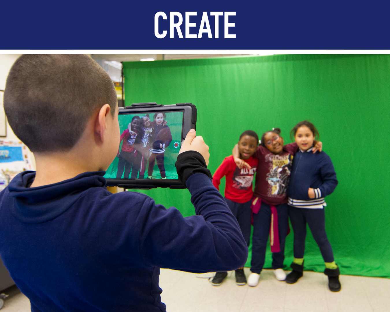 Create: student producing video on green screen