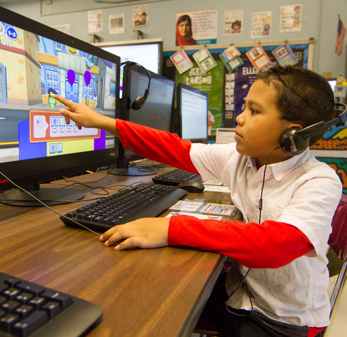 Student playing coding game in classroom