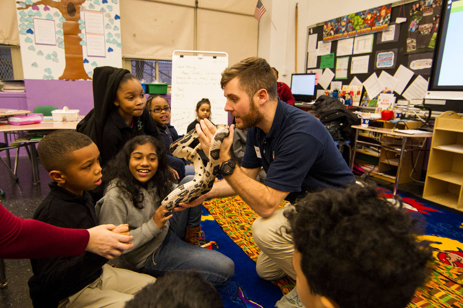 Specialist from Bronx Zoo shows students snake