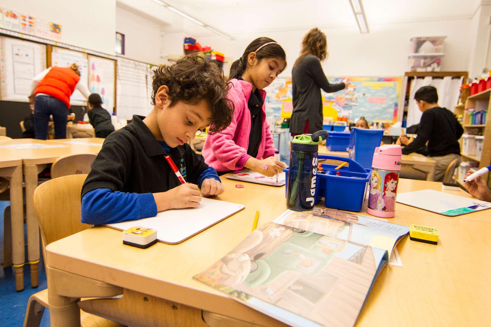 Kids using dry erase boards