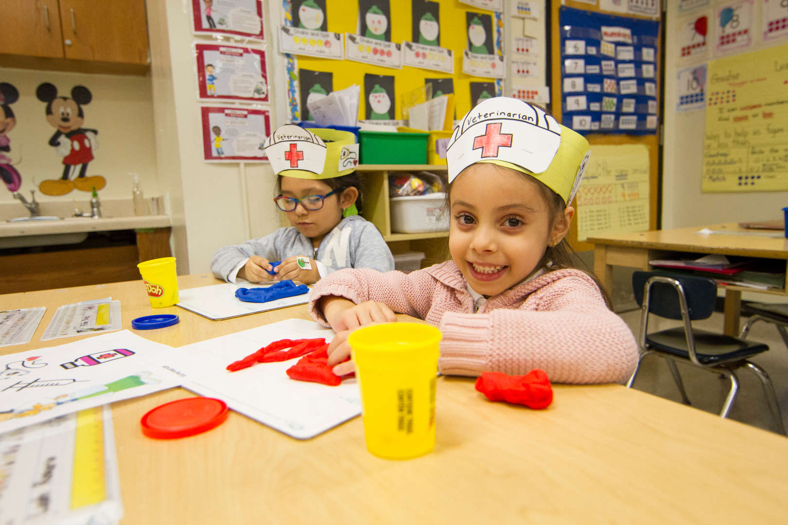 Kindergarteners playing with play-doh