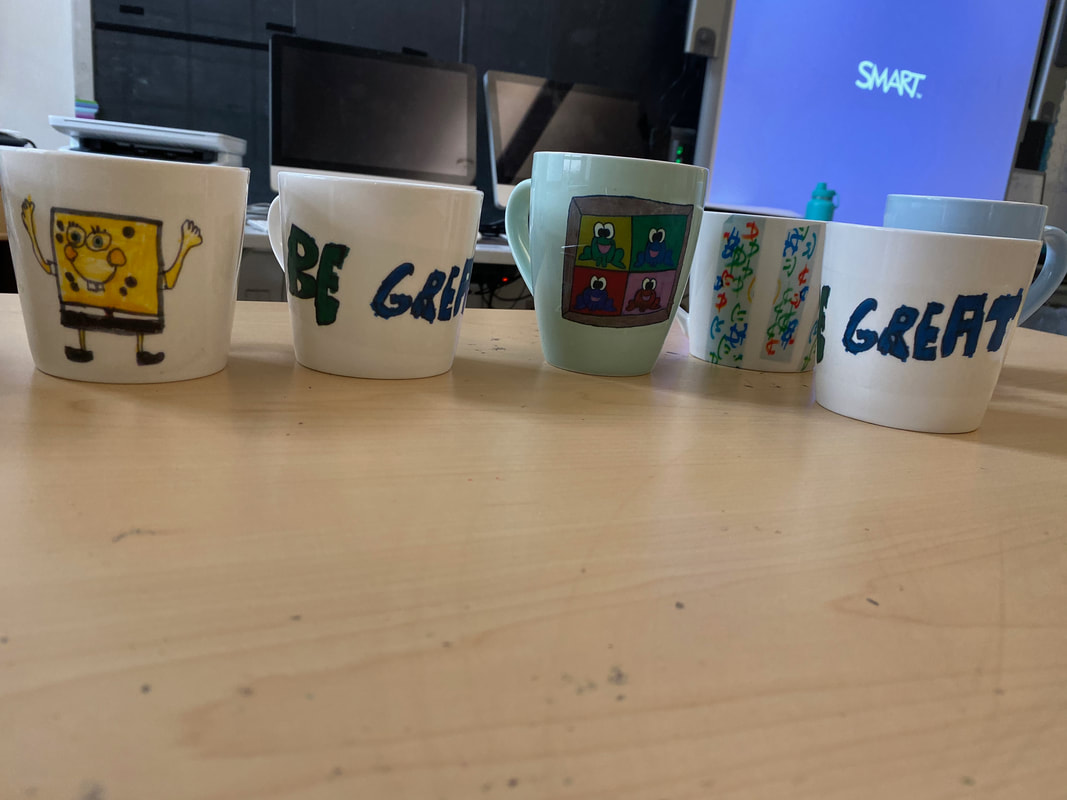 Mugs made by students, including Sponge Bob mug and mugs with words