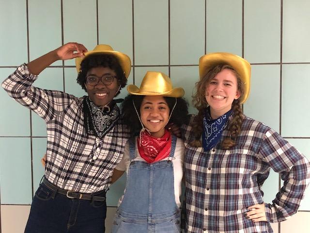 Three students dressed as farmers during Spirit Week