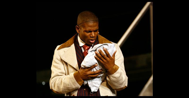 Coalhouse holding his son.