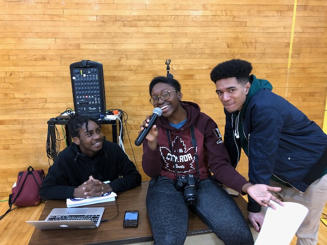 Student on microphone emceeing event