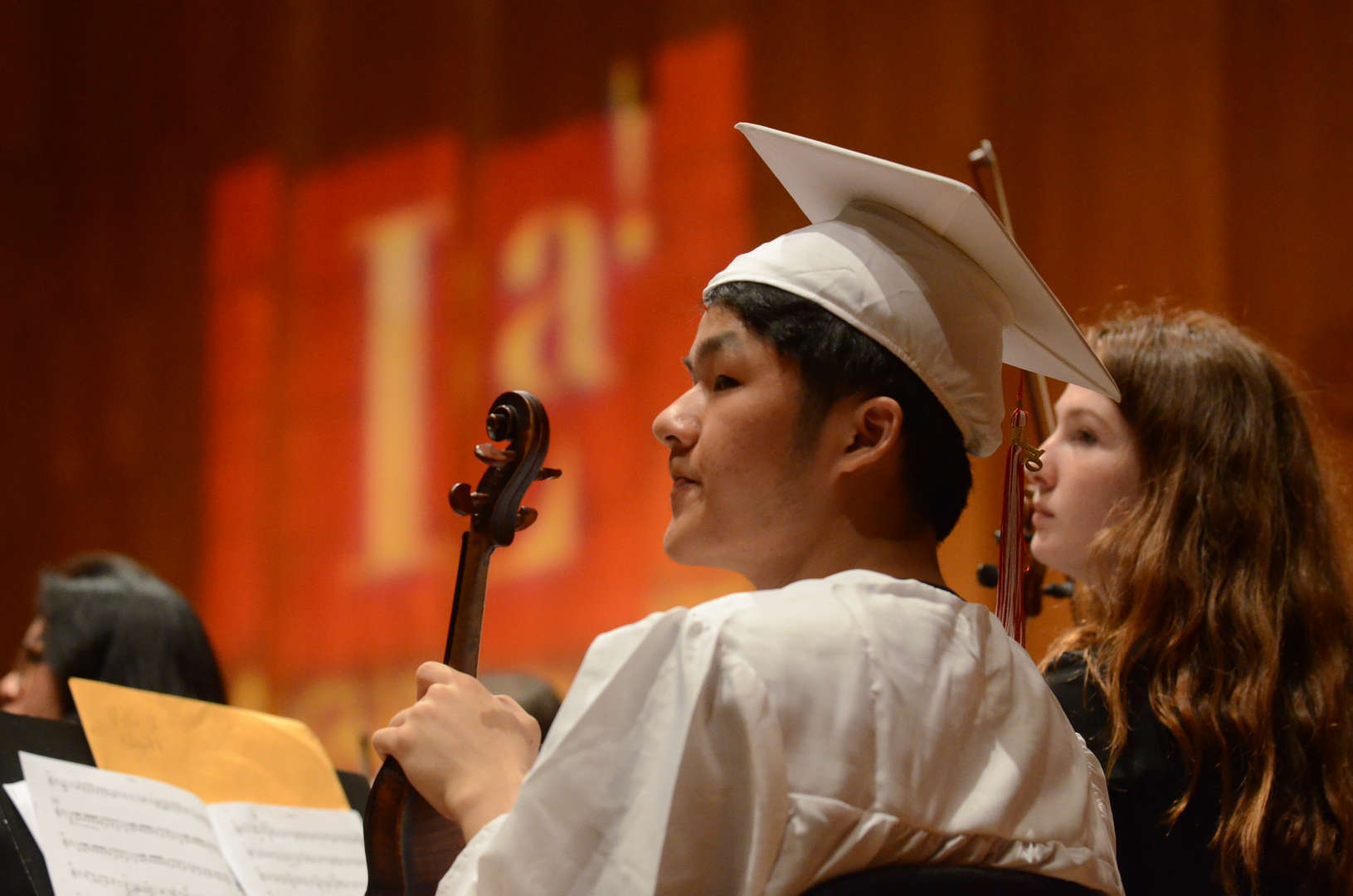 Instrumentalist in Cap and Gown at Graduation