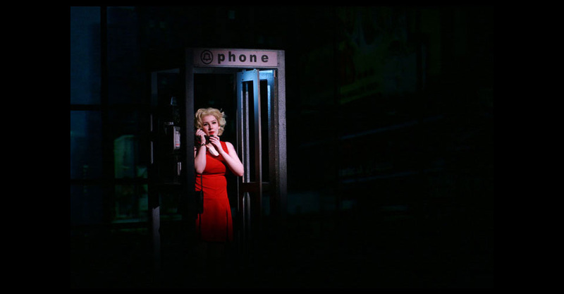 Charity talking while at a pay phone.