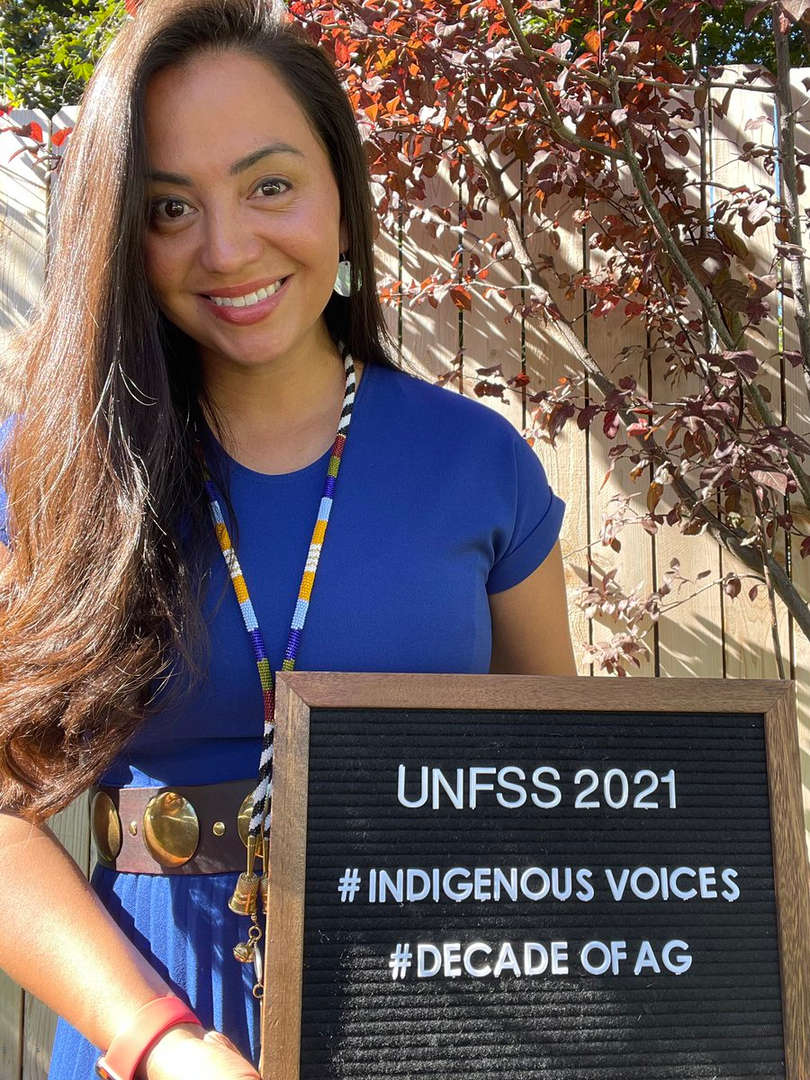 Indigenous American Woman Holding Sign