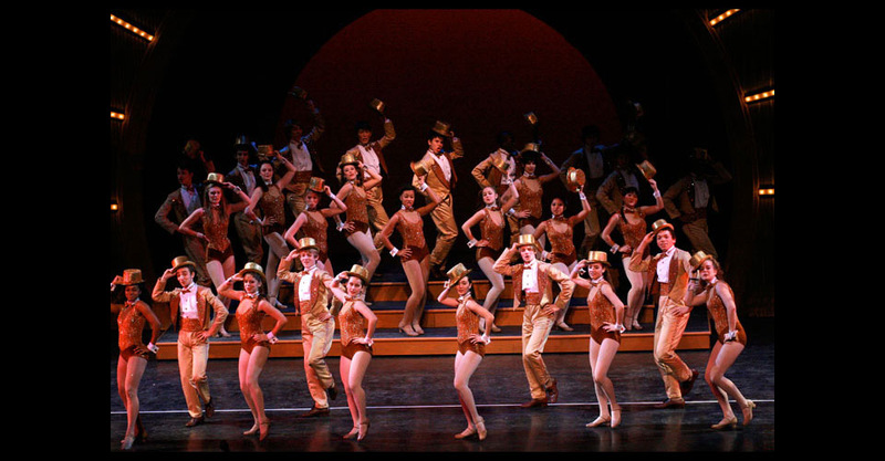 """Large group in finale costumes performing """"One"""""""