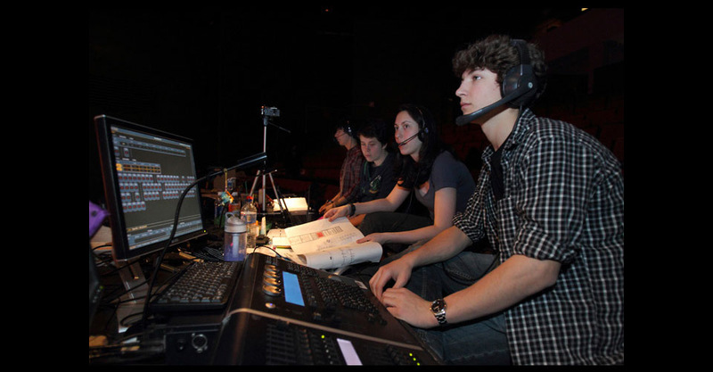Crew at tech table during rehearsal.