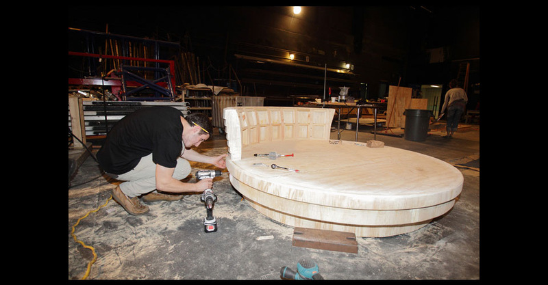 Students working on Vittorio's round bed.