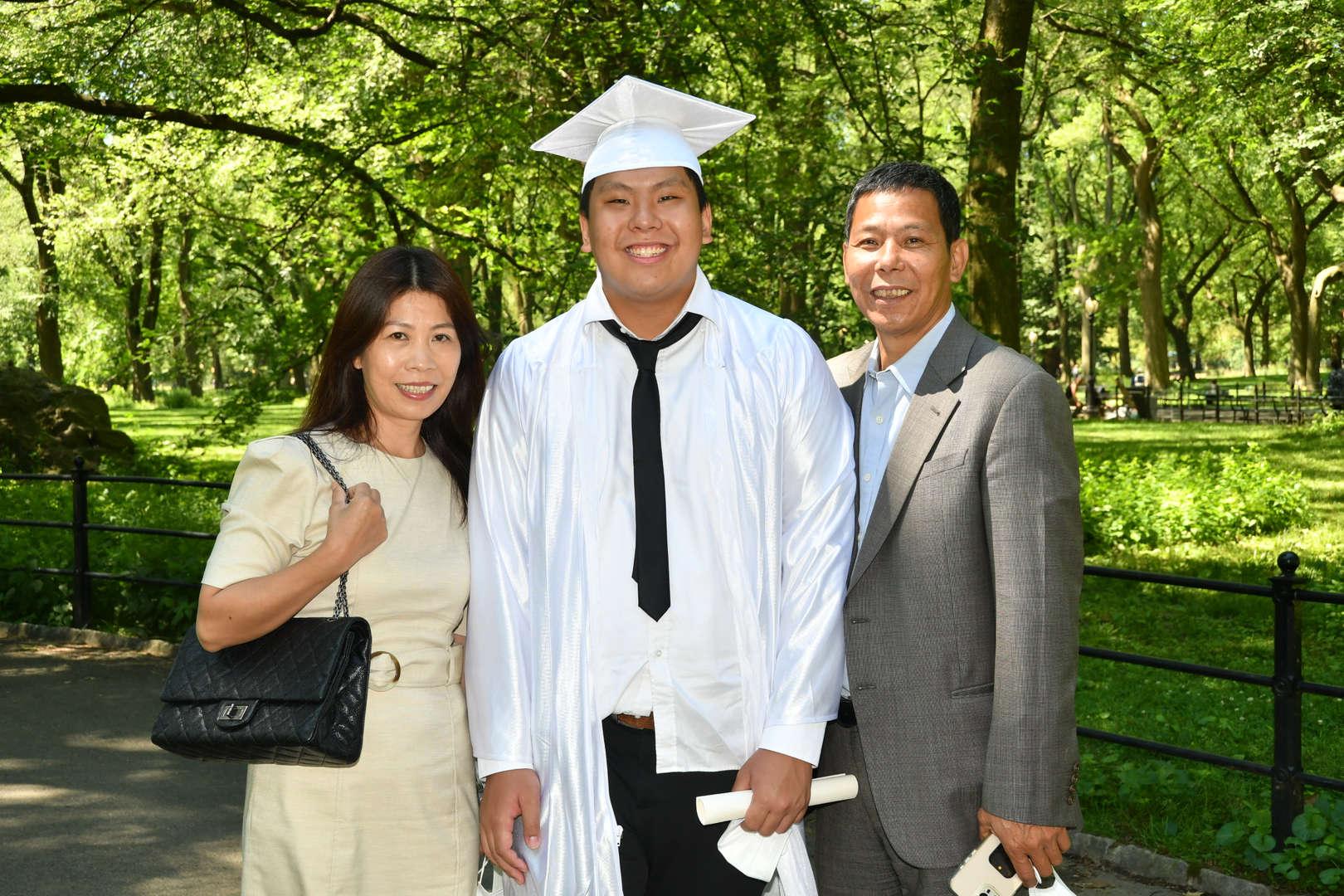 Graduate standing between parents