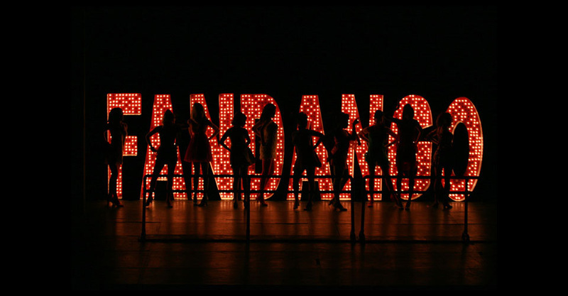 The taxi dancers are backlit by the ballroom's giant Fandango sign.