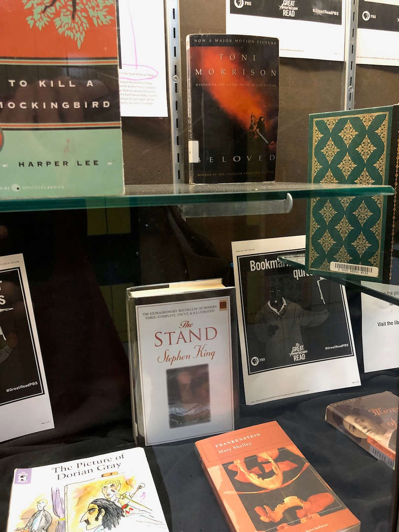 Library Recommended Books in glass display case.