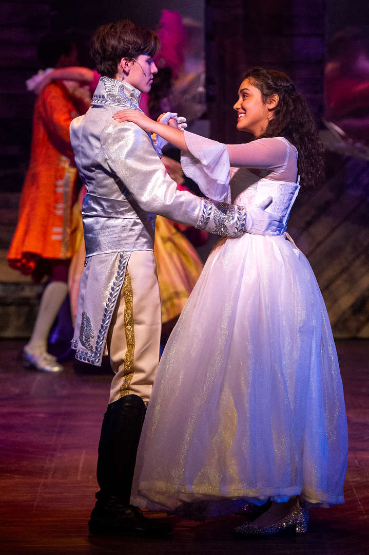 Cinderella and Prince Charming dancing.