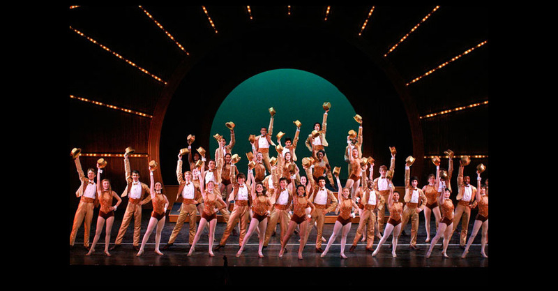 """The company of """"A Chorus Line"""" holding the final pose."""