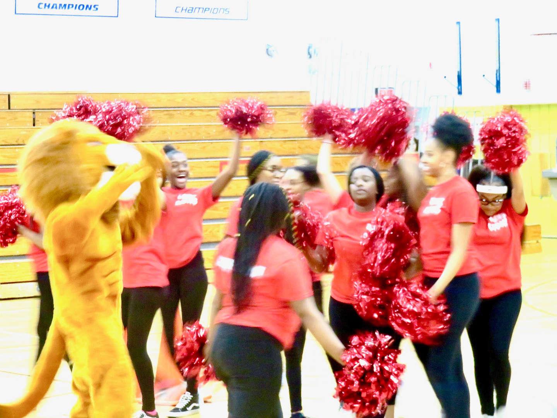 Cheerleaders and mascot at pep rally