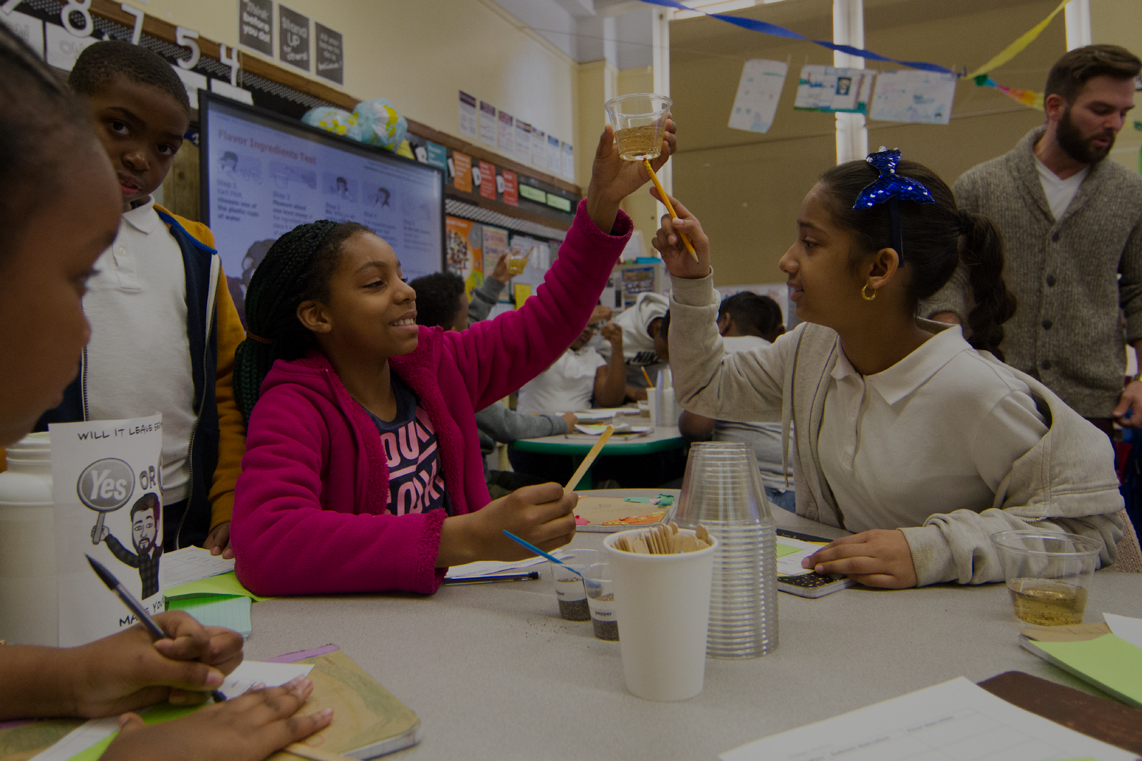 Students holding up science experiment