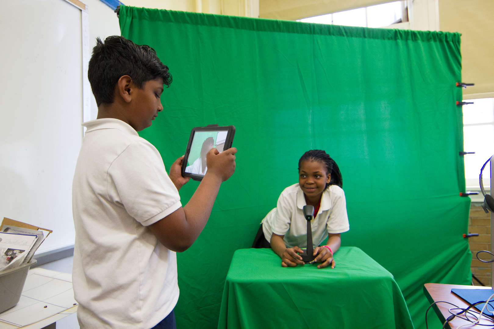 Kids creating video using green screen