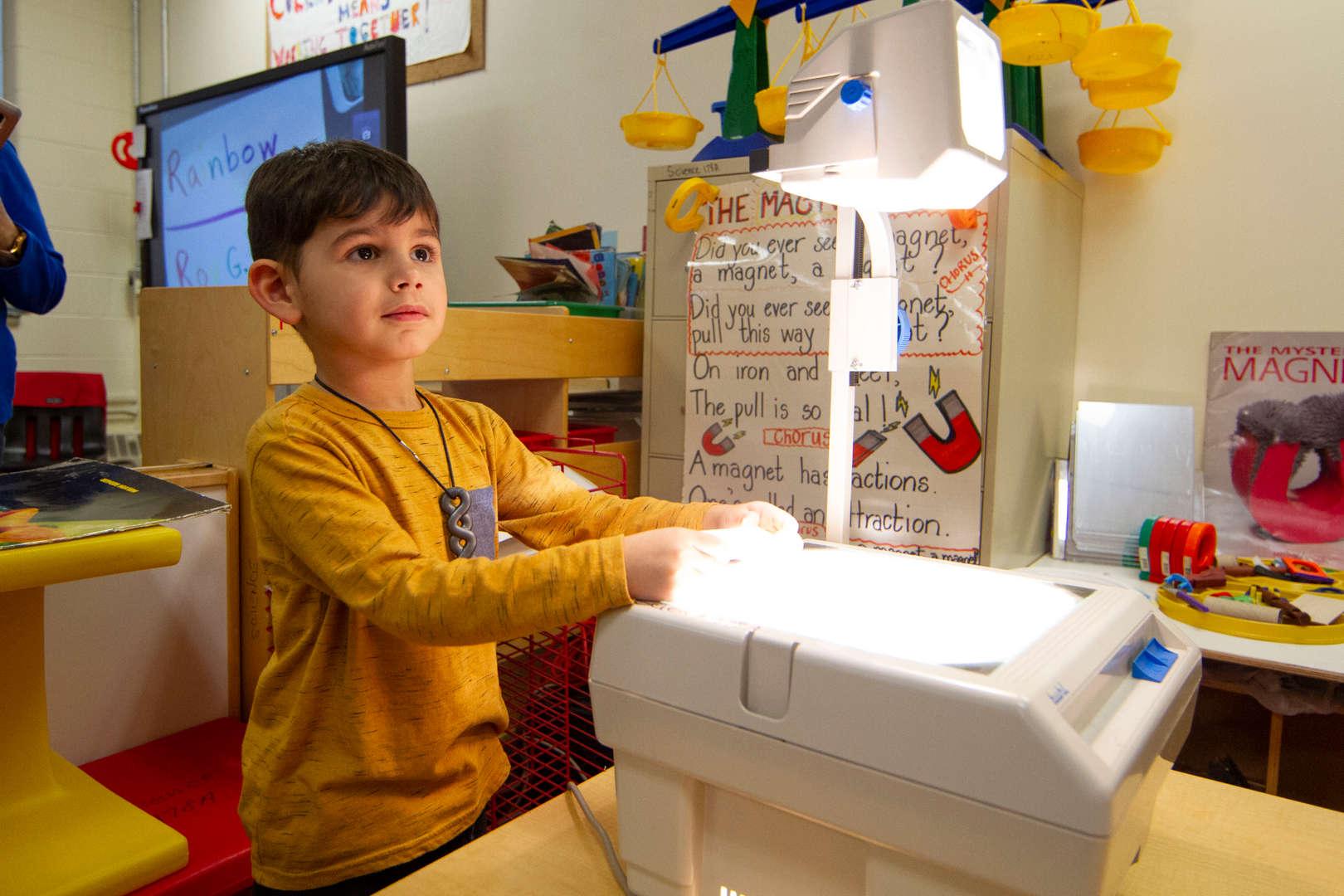 Boy using projector