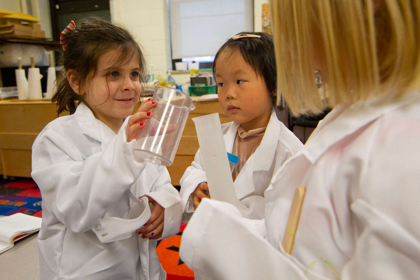 Girls conducting science experiment