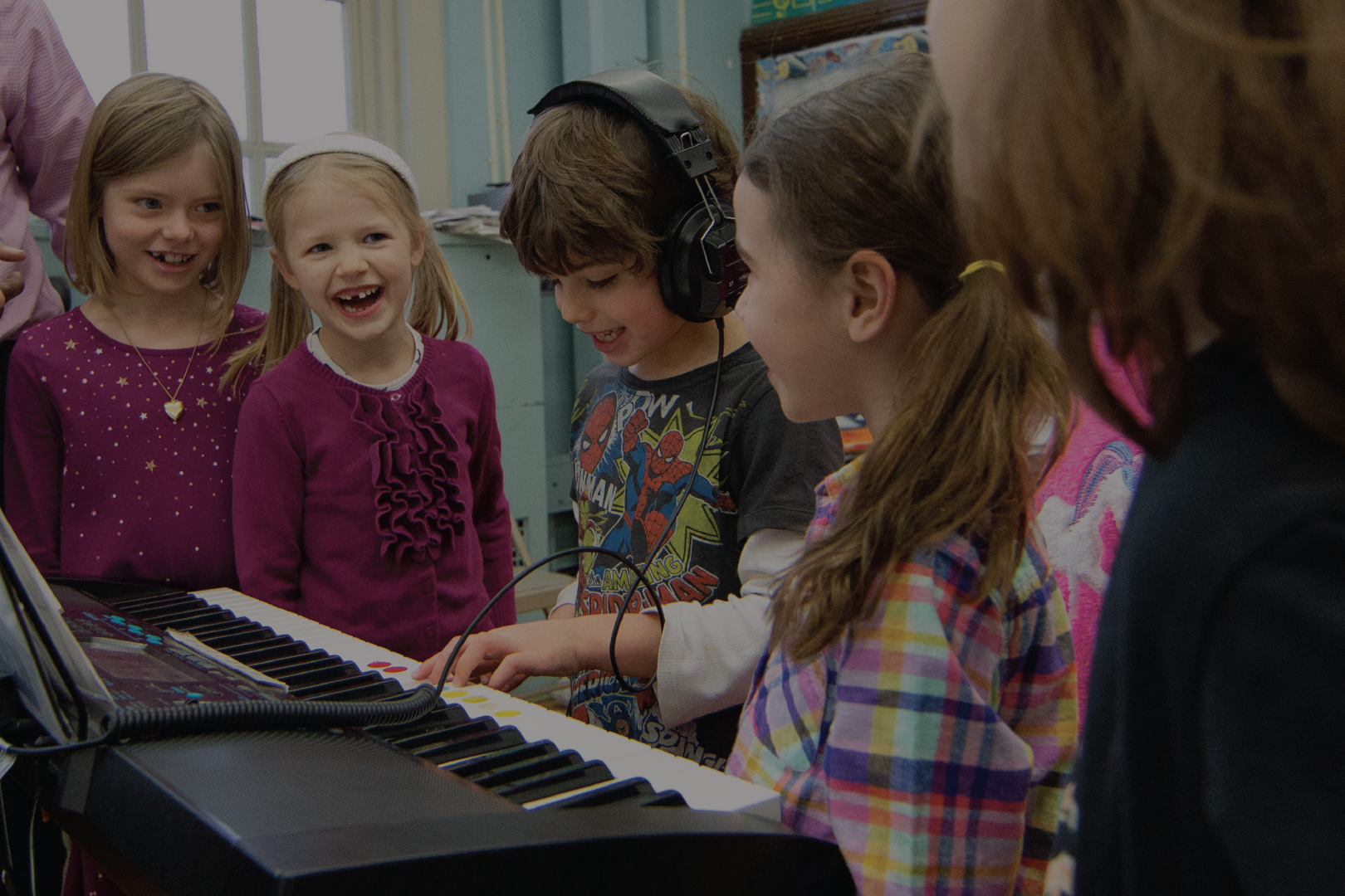 Kids playing on the piano