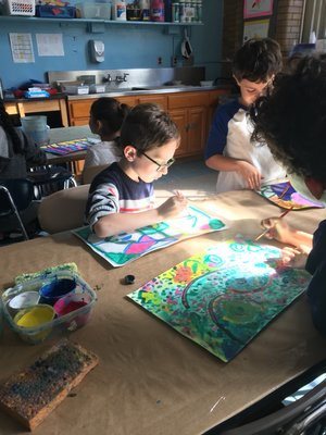 Students working on paintings