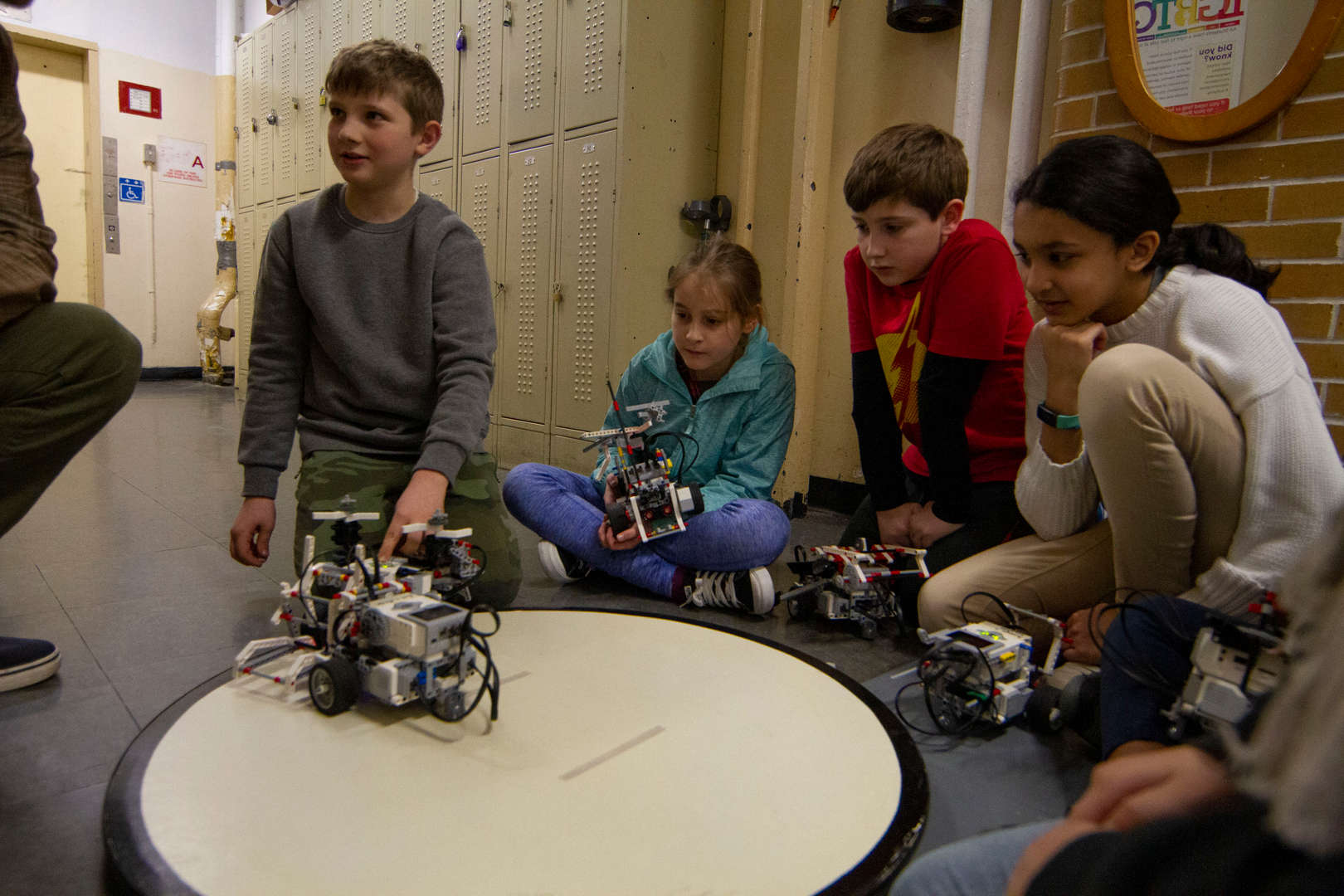Students playing with motorized robots