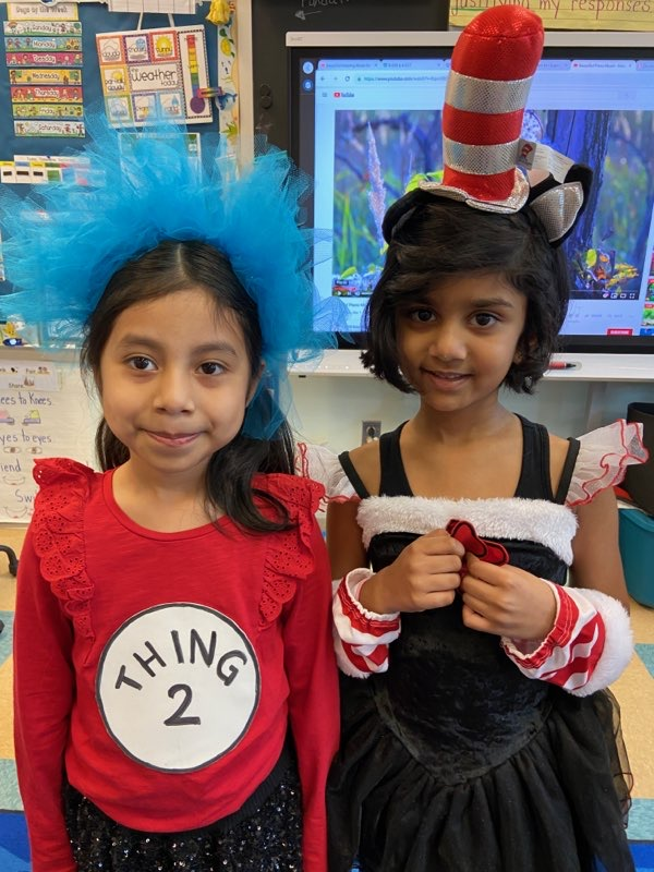 students smiling dressed up for Dr. Seuss's birthday