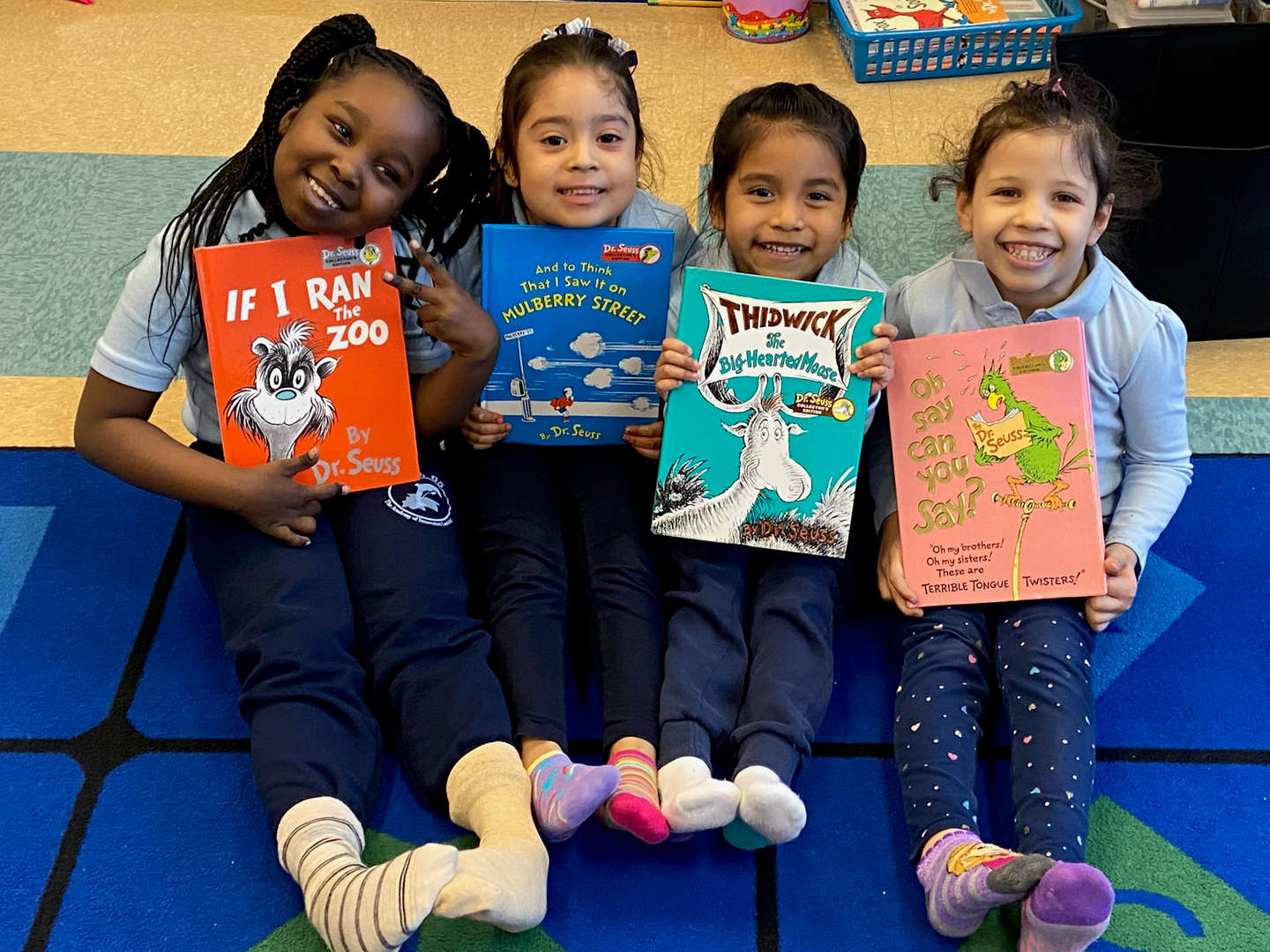 students smiling holding different Dr. Seuss books