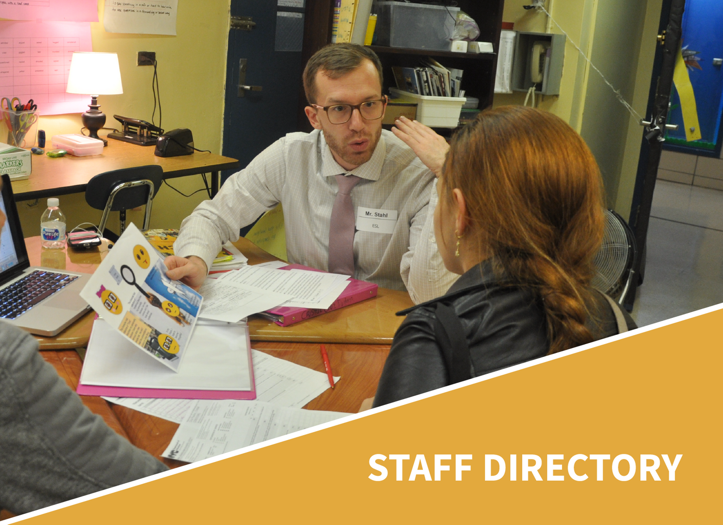 Staff Directory - ESL teacher working with students