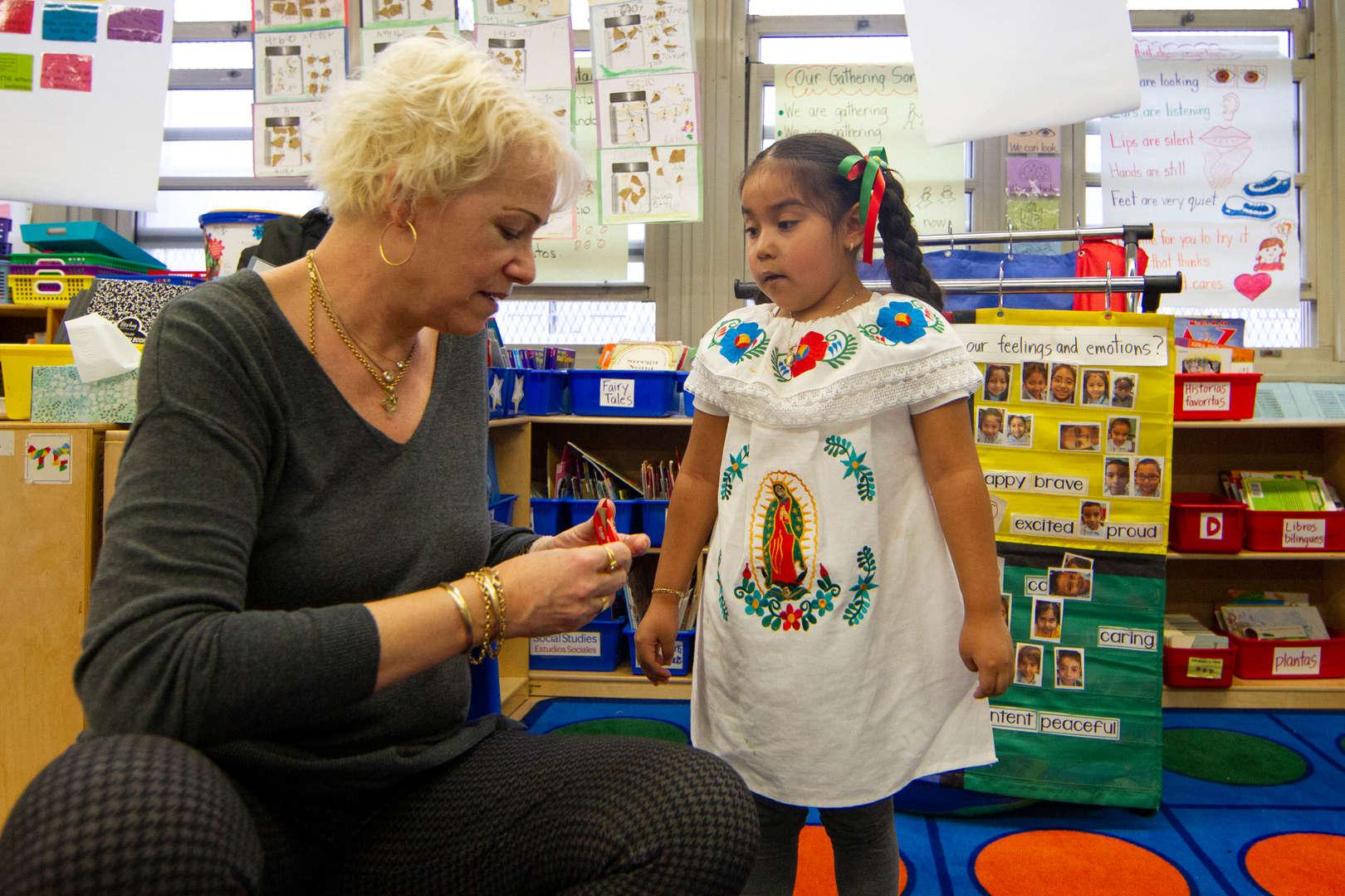 Child working with teacher