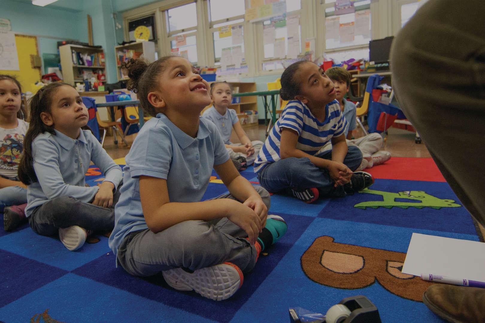 Children listening to lesson