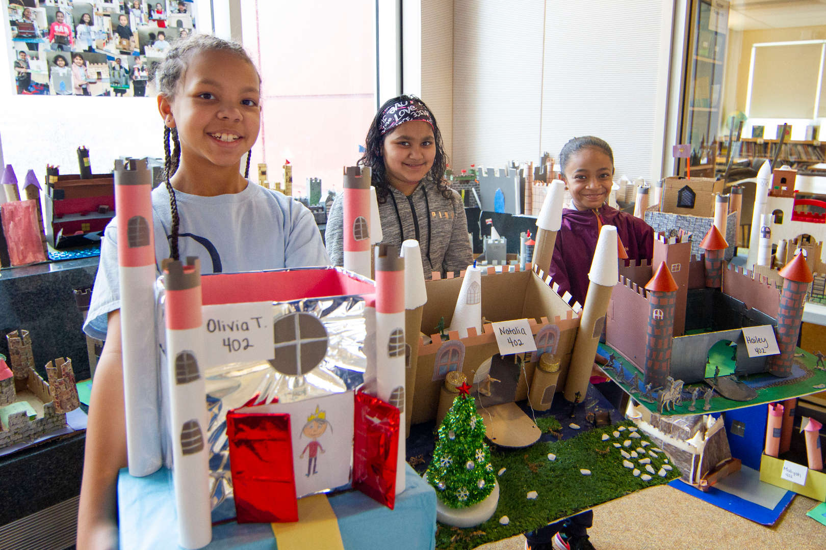 Kids showing their castle projects