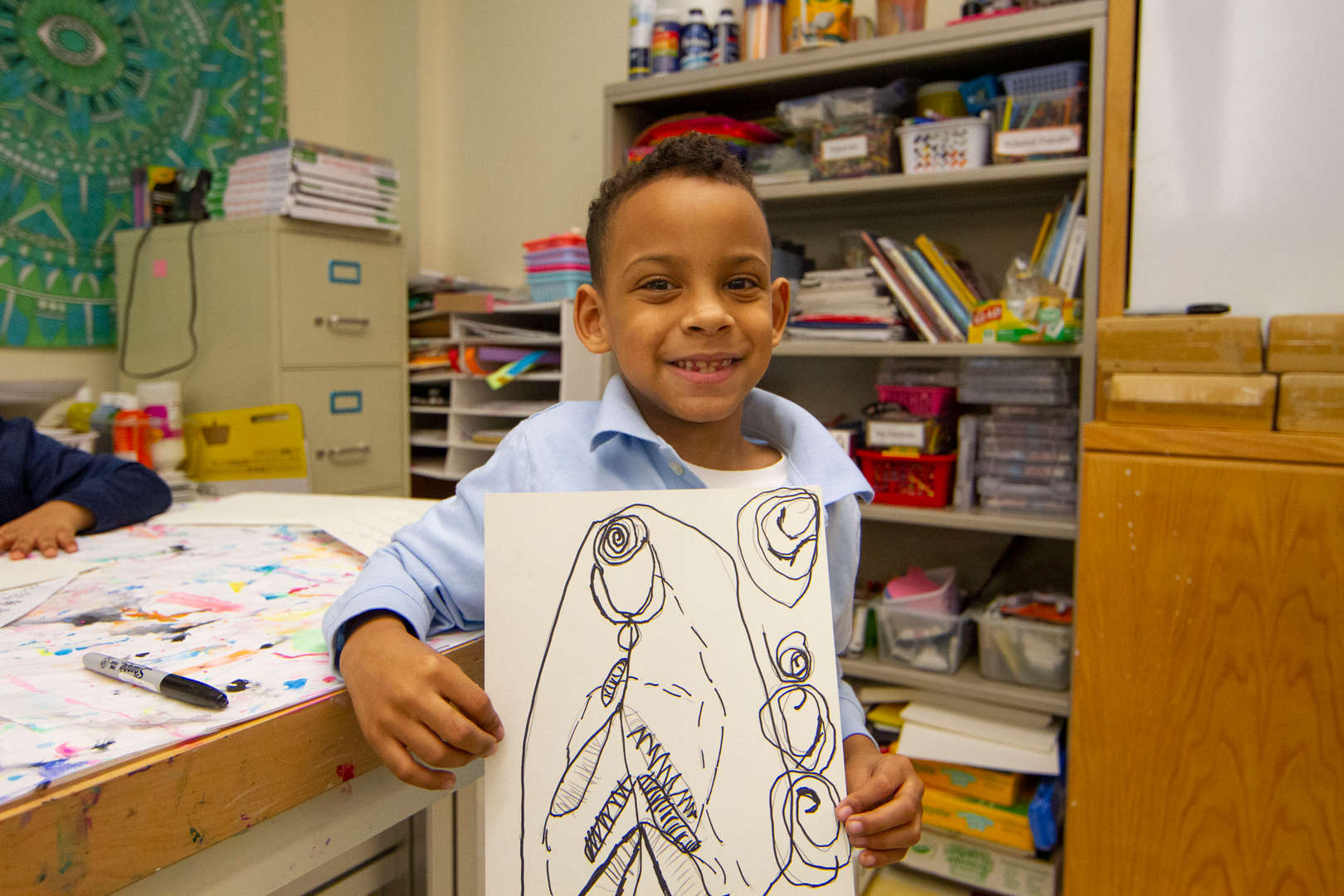 Child holding up drawing