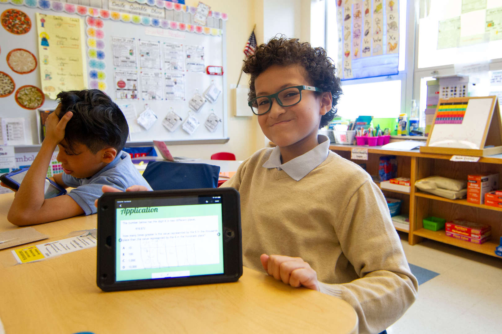 Boy showing iPad screen