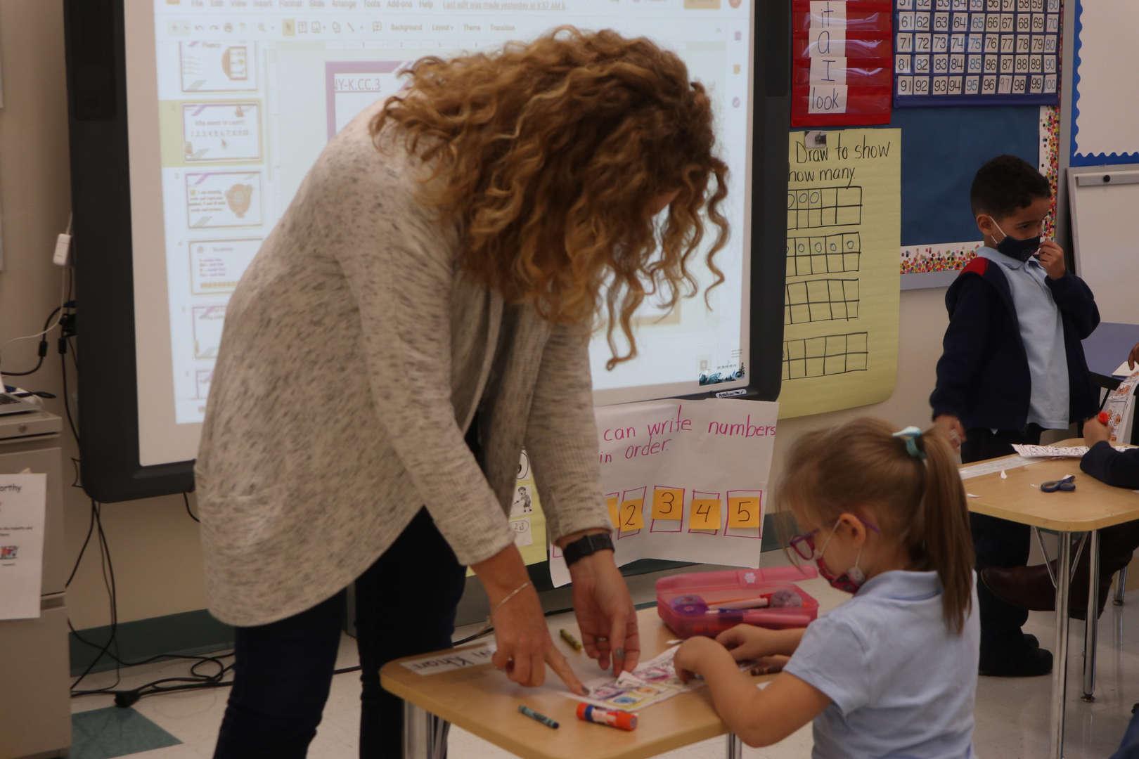 Ms. Murray helping a kindergarten student