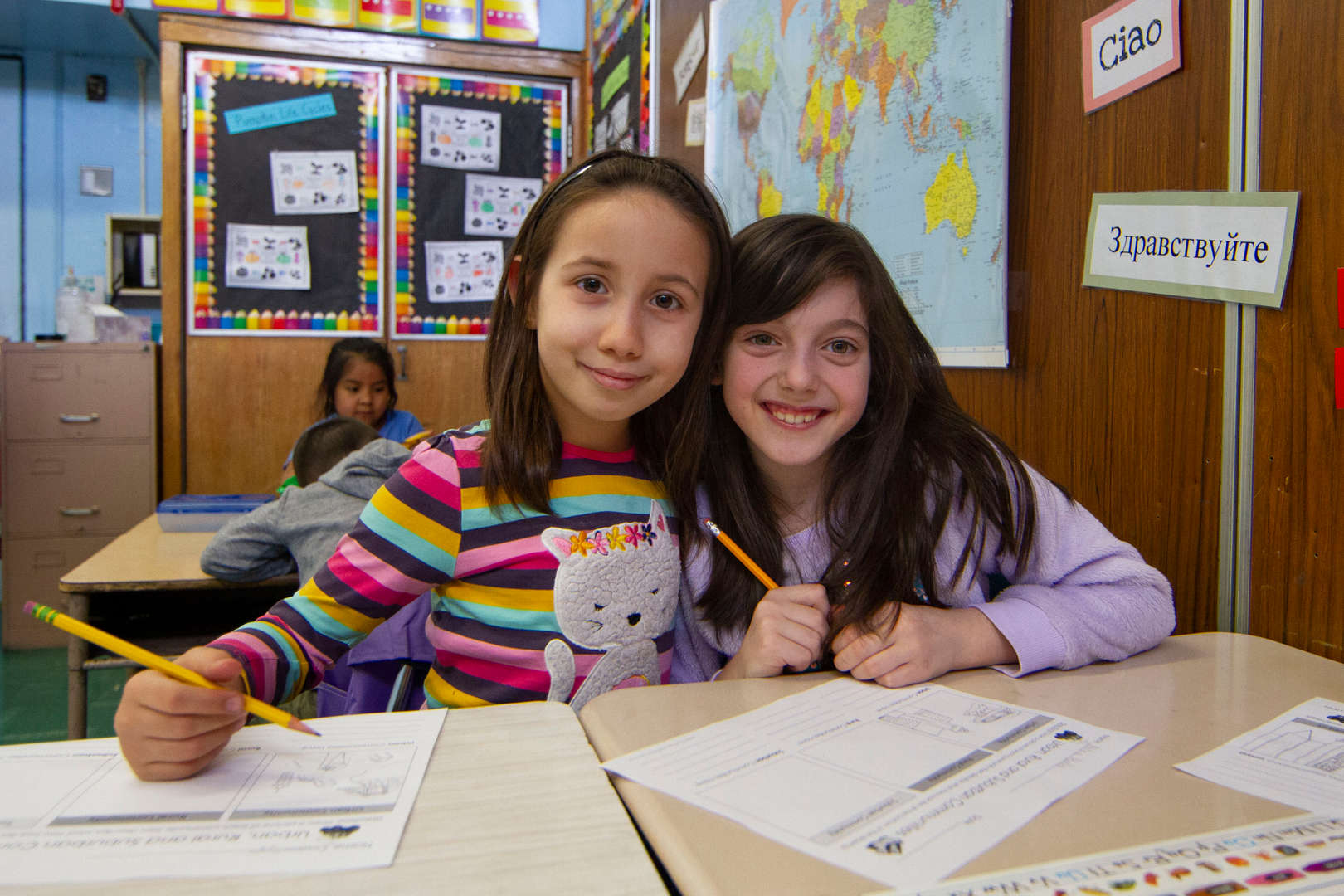 Girls working together on class project